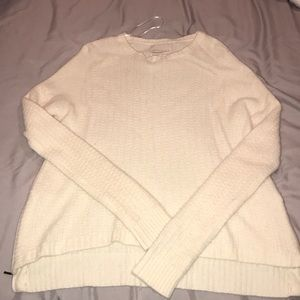 Cream cashmere sweater with zipper accents